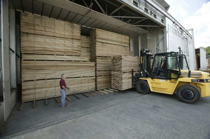 Forklift loading kiln with lumber to dry